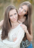 Portrait of two beautiful sisters Stock Image