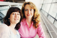 Portrait of two beautiful women. Portrait of two beautiful real 40 years old women Stock Photos