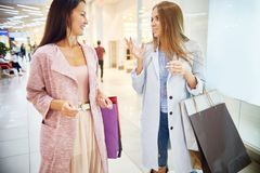Young Women Enjoying Shopping in Mall Royalty Free Stock Images