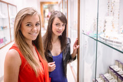 Portrait of two beautiful women in a store Royalty Free Stock Image