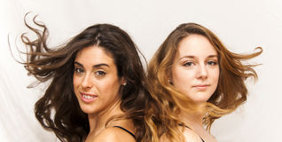 Portrait of two beautiful women who were moving her hair Stock Photography