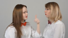 Portrait of two beautiful young women. With butterflies on their neck smiling, emotions. Leading, entertainer in the studio stock video footage