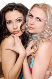 Portrait of two beautiful young women. Isolated Stock Photography