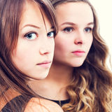 Portrait of two beautiful young women. Stock Images