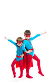 Portrait of two boys in the full-length plays a superhero. Stock Photos
