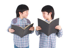 Portrait of two boys holding books. Royalty Free Stock Photos