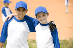 portrait two boys posing for camera at baseball match Stock Images