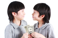 Portrait of two boys, twins holding money. Isolated on white Royalty Free Stock Photography