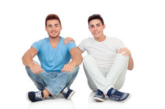 Portrait of two brothers sitting Stock Photos