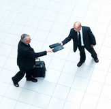 Portrait of two business men exchanging files Royalty Free Stock Photos