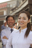 Portrait of two Business People, focus on businesswomen, outdoors, Beijing Stock Photos