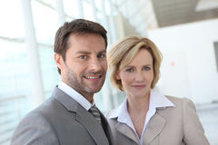 Portrait of two business people indoors Stock Images