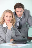Portrait of two business people with laptop Royalty Free Stock Photography
