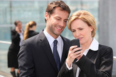 Portrait of two business people outdoors Stock Images