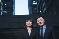 Portrait of two business people outdoors among skyscrapers in Beijing Royalty Free Stock Photos