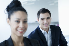 Portrait of two business people smiling and looking at the camera stock photography