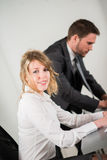 Portrait of two business people working together i Stock Images