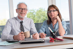 Portrait of two business people working together Royalty Free Stock Photography