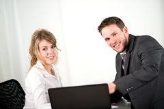 Portrait of two business people working together in office with computer Royalty Free Stock Image