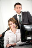 Portrait of two business people working together in office with computer Stock Photo