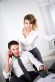 Portrait of two business people working together in office with computer Royalty Free Stock Photos