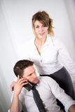 Portrait of two business people working together in office with computer Stock Photos