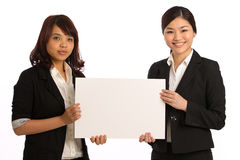 Portrait of two business woman holding a sign Stock Image