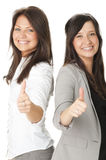 Portrait of two businesswomen showing thumbs up Stock Photography
