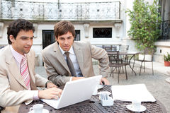 Business men meeting in cafe. Royalty Free Stock Photography