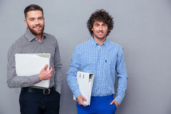 Portrait of a two casual businessmen holding folders Stock Images