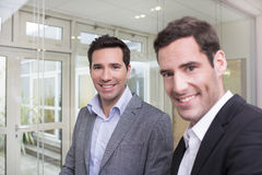 Portrait of Two casual businessmen working together in office Stock Images