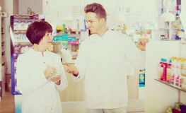 Portrait of two cheerful adult pharmacists Royalty Free Stock Photography