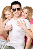 Portrait of a two cheerful blonde women with young man royalty free stock photography