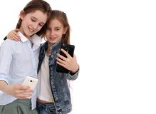 Portrait of two cheerful girls, girls take a selfie royalty free stock image