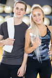 Portrait of two cheerful people having a break at gym Stock Photo