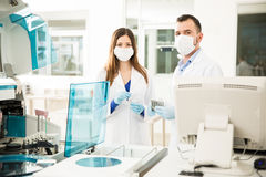 Portrait of two chemists at work in a lab Royalty Free Stock Photos