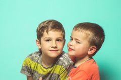 Portrait of two children on a blue background stock photography