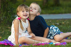 Portrait of two children boy and girl brother and sister sitting Stock Images