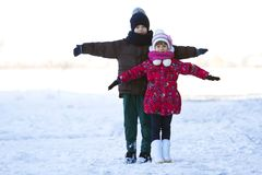 Portrait of two children boy and girl playing outdoors in winter Stock Photography