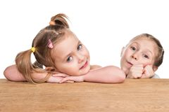 Portrait of two children at a desk royalty free stock photography