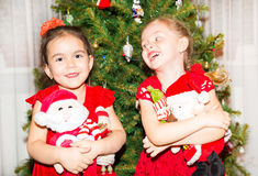 Portrait of two children girls around a Christmas tree decorated. Kid on holiday new year. Portrait of two children girls around a Christmas tree decorated. Kid Royalty Free Stock Photo