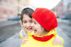 Two little sisters. Portrait of two children outdoors in early spring royalty free stock images