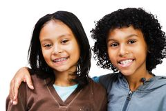 Portrait of two children smiling. Isolated over white Royalty Free Stock Images