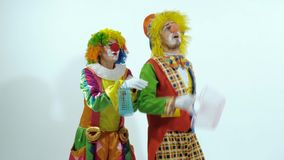 Portrait of two clowns having fun together holding little baskets stock video