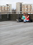 Portrait of two college students. Studying/working on a laptop computer on campus on a terrace Stock Images