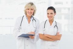 Portrait of two confident female doctors Royalty Free Stock Images