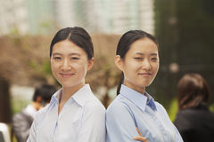 Portrait of two confident young businesswomen in Beijing, looking at camera Stock Photo