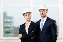 Portrait of two contractors. Standing near each other Royalty Free Stock Photography