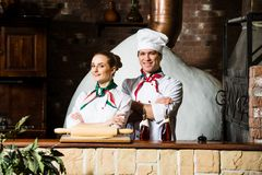 Portrait of two cooks Stock Photography