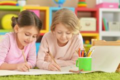 Little girls drawing  together. Portrait of two cute little girls drawing together Stock Images